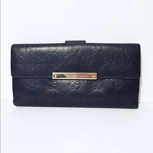 Gucci embossed monogram snap button long wallet